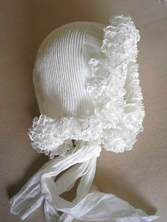Antique Victorian ruffled lace and pintucked bonnet.  Lovely.