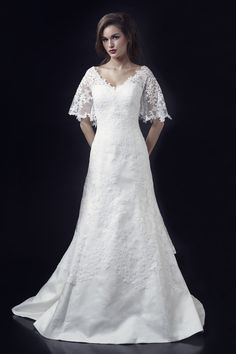 Modest style wedding dress with short flutter sleeves. Chloe Adele (front)