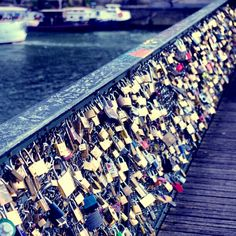 I want to go to Paris one valentine's day and take pictures of all of the couples that add their locks to this bridge.