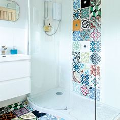 Modern white bathroom with patchwork wall and floor tiles