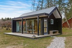 Scandinavian Modern Tiny House, Absolutely Small House Design A small village on the east coast of Jutland is the setting for this tiny house on a foundation. Small Tiny House, Small Modern House Plans, Tiny House Cabin, Tiny House Living, Small House Design, Small House Plans, Modern House Design, Small Homes, Tiny Cabins For Sale