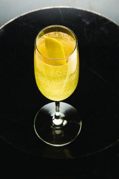 Arnaud's French 75 Cocktail Recipe | SAVEUR cognac, lemon juice, simple syrupChampagne, Lemon peel