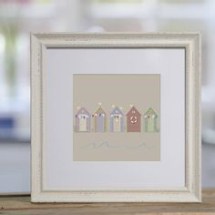 seaside huts framed print by sophie morrell | notonthehighstreet.com
