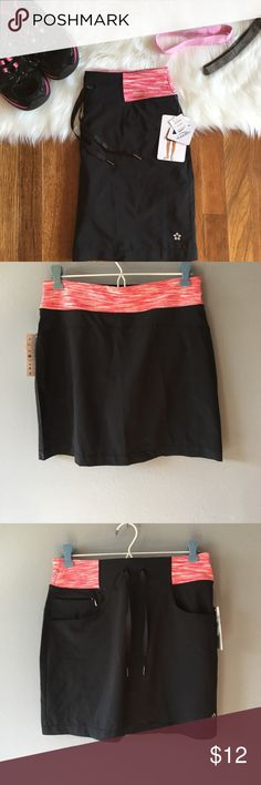 NWT Athletic Skirt Pink/Black NWT from Costco. Great quality. Skirts