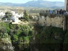 """Places to see in ( Ronda - Spain ) El Tajo  El Tajo is a gorge on which is located the city of Ronda  province of Malaga  autonomous community of Andalusia  Spain . El Tajo has an area of 47.5 ha approximately and a gorge excavated by the river Guadalevín of 500 m of length and 100 m of depth. El Tajo width is 50 m and El Tajo has a large escarpment that opens to """"La Caldera"""" hollow in a circular shape.  The Caldera is covered by scattered scrub which also appears hanging in the escarpment…"""
