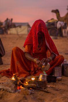 Gypsy woman cooking at Pushkar Camel Fair, India