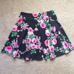floral print mini skirt Adorable flower skirt about mid thigh length. Cotton material very light and comfortable. Stretchy! Worn once.  LIKE IT? MAKE AN OFFER! None  Skirts Mini