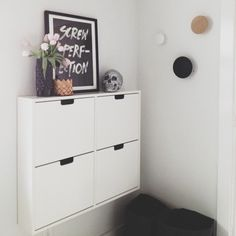I am in LOVE with these shoes storage cubbies from Ikea. Photo by amerrymishap