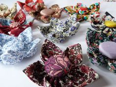 Hand stitched flower brooches.