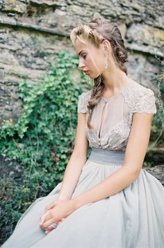 The essence of romance! See this wedding gown by Maria Luisa Rabell on SMP: http://www.StyleMePretty.com/2014/01/31/romantic-grey-gold-wedding-inspiration/  Darcy Benincosa Photography