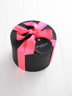 GIFT WRAPPING: The Special Delivery Company Hat Box with neon pink ribbon. Available from www.thespecialdeliverycompany.com.au