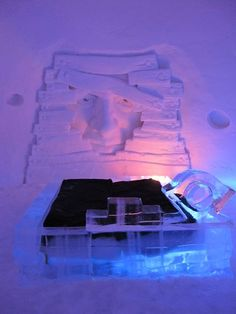 Sleeping on a bed of ice in Lapland's Snow Village, Finland.