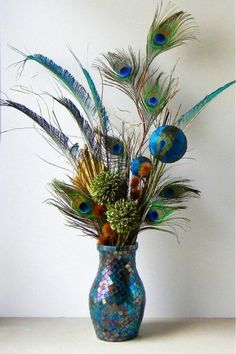 Floral Arrangements- Peacock Floral Arrangement with Mirrored Vase