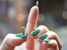 This teeny family enjoy a picnic, on artist Alice Bartletts nails, which are coated in a grass-like covering
