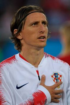 Croatia's midfielder Luka Modric stands for the national anthems prior to the Russia 2018 World Cup Group D football match between Croatia and...