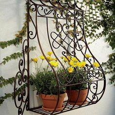 Don't you love the Old Country feel of this wall planter?