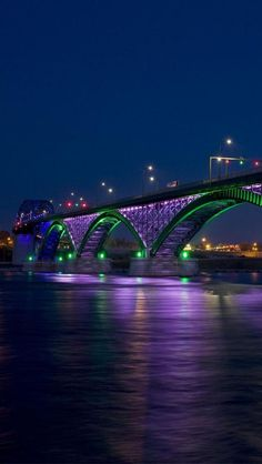 Peace Bridge, Niagara River, lighted in purple and green at night -  It connects the City of Buffalo, New York, in the United States to the Town of Fort Erie, Ontario, in Canada