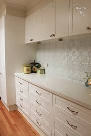 pressed tin splashback in white laundry