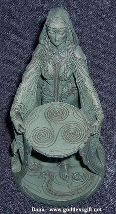 Danu is the great mother of the gods, of Ireland and the divine creator who birthed all things into being. She is also an earth goddess. She is connected to the Fairy Hills and has associations with Dolmens also known as a portal tomb, or portal graves.  She is the Mother of The Tuatha De Danann, the Irish Gods, which literally means the Children of Danu.