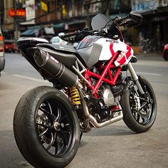 Clean custom 'Pramac' Hypermotard 796 with SC Project exhaust system.