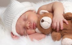 baby photography | newborn in a hat with a stuffed bear