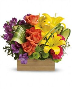 Its impossible not to light up at the sight of this brilliant box of blooms. Radiant as a rainbow, this lush, luxurious gift blends modern style with the timeless beauty of lilies, roses and alstroemeria