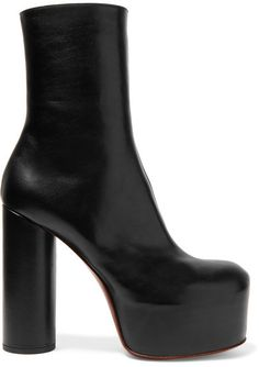 Boots grounded every look on the Vetements Fall '16 runway. This supple black leather pair is set on a towering cylindrical heel that's tempered with a substantial platform. Style yours with a slouchy sweater and cut-off jeans.