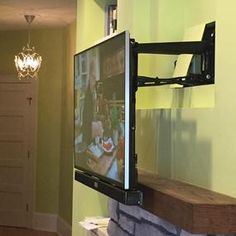 Curved Flat Screen Tv Mounted Over Fireplace Sound Bar