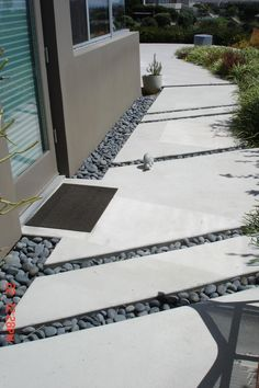 Concrete steppers with pebble borders