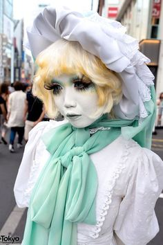 Minori is a well-known shironuri artist who is seen around Harajuku quite often. Minori just announced that she will be a featured guest at Anime Matsuri 2015 in Houston, Texas. Minori's outfit this time features a white vintage dress with a handmade hat, green scarf, green vintage bag, white gloves, white tights, and handpainted gold heels. As always, her handpainted shironuri makeup is a big highlight of the look. (Tokyo Fashion, 2014)