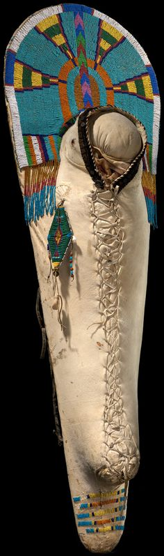 Bannock cradle board  ca. 1900–1920  Fort Hall Reservation, Idaho  Wood, hide, glass and bone beads, cotton thread, brass sequins and jingles, cowrie shells, velveteen