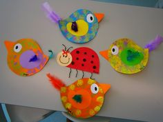 Sponge painted birdies with real tail feathers.