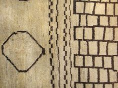 These Moroccan design rugs are HOT right now and they are so beautiful. Modern and tribal at the same time.