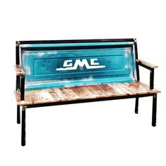 Blue Collar Bench GMC Blue by Roque Castro  The handcrafted piece's square steel frame supports a striking backrest—formed by the tailgate of a 1960s-era GMC truck—and a seat made of antique barn wood.