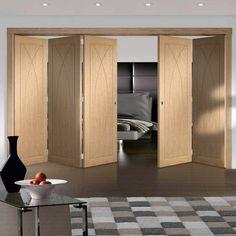 Thrufold Pesaro Oak Flush Panel 3+2 Folding Door  - Lifestyle Image.    #oakfoldingdoors #modernfoldingdoors