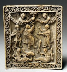 A German ivory plaque carved with the scene of Christ's Ascension, c.1050; the Ocean and Earth are personified at the bottom with a symbolic fish and vegetation; only Christ's feet are depicted, and the hand of God, reaching down from heaven. (Metropolitan Museum of Art)