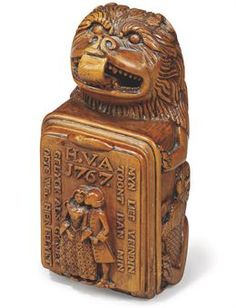 A DUTCH BOXWOOD LOVE TOKEN SNUFF BOX  Carved with the figure of a lion, flanked by the figures of a merlion and mer-demon, the cover carved with the figures of a man and woman embracing, with the inscription MYN LIEF VRINDIN TOONT DAN MIN GERLYCK ALS GY SIET OFTE HIER BELYKT below the initials and date H.V.A. 1767, the inner side of the lid inset with a looking glass  4¼ in. (10.6 cm.) long; 2¼ in. (5.6 cm.) deep (2)