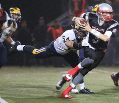 Mount Si's Nick Mitchell is sacked by Bellevue's Shane Bowman in the second quarter. See more of Seattle Times photographer Colin Diltz's photos from the game.