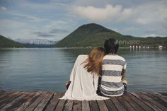Young couple sitting on wooden pier by kitzstocker on PhotoDune. Young couple sitting on wooden pier and looking view of nature Couple Picture Poses, Couple Pictures, Poses For Photos, Photo Poses, Young Couples Photography, Themed Engagement Photos, Sitting Poses, Romantic Couples, Drawing People