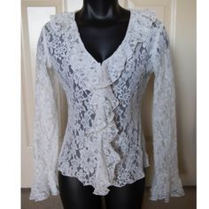 ⬜️White Lace Long Sleeve Blouse Romantic Elegant⬜️ This Ruffles white lace blouse is so pretty! It features hook and eye closure front all the way to the bottom. Ruffles at the middle and flared sleeves. Size: Medium. Brand: INC International Concepts. INC International Concepts Tops Button Down Shirts