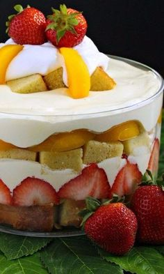 Homemade pound cake, strawberries, peaches and a vanilla cream filling make this trifle over-the-top, refreshing and easy to make for any summer gathering. Easy To Make Desserts, Cold Desserts, Pudding Desserts, Chocolate Desserts, Chocolate Trifle, Trifle Desserts, Peach Trifle, Strawberry Trifle, Strawberry Filling