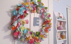 I love this wreath idea, I have so many scraps of material and the colours of this one are particularly smile-inducing. Full tutorial at http://howtonestforless.com/2011/08/29/bedroom-bling-fabric-scrap-door-wreath/ And a pic of a fab red and turquoise fabric scrap wreath.