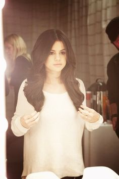 Selena Gomez. I love her hair. Wish I could do the middle part.