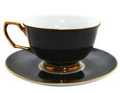 Black and gold trim tea cup and saucer