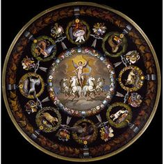 Circular tabletop with central micromosaic image of Cupid in a chariot drawn by four white horses, the border with symbols of the planets within foliage wreaths. The tripod pedestal base has a waisted column with a central knop and a spreading base with three legs.