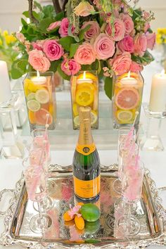 Don't forget about the romance of candles and champagne! Do the same with citrus slices for a candle-holder for an equally deliciously scented impact.
