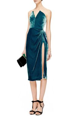 Indulge in the lavish texture and dramatic silhouette of this strapless teal velvet **Cushnie Et Ochs** dress. With a bustier boned bodice, plunging neckline, and thigh-high slit, the decidedly enticing design is a destined statement-maker.