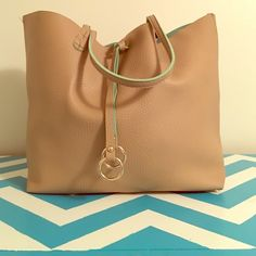 Tan and Green Tote Plain Tan tote with sea foam green interior. Brand new. No pockets on the inside. Cee Klein Bags Totes