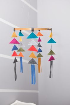 Fun, colorful arrow-inspired mobile - what a fab modern touch to this nursery!