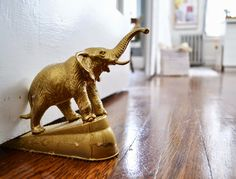 Max Makes Home - gold elephant doorstop